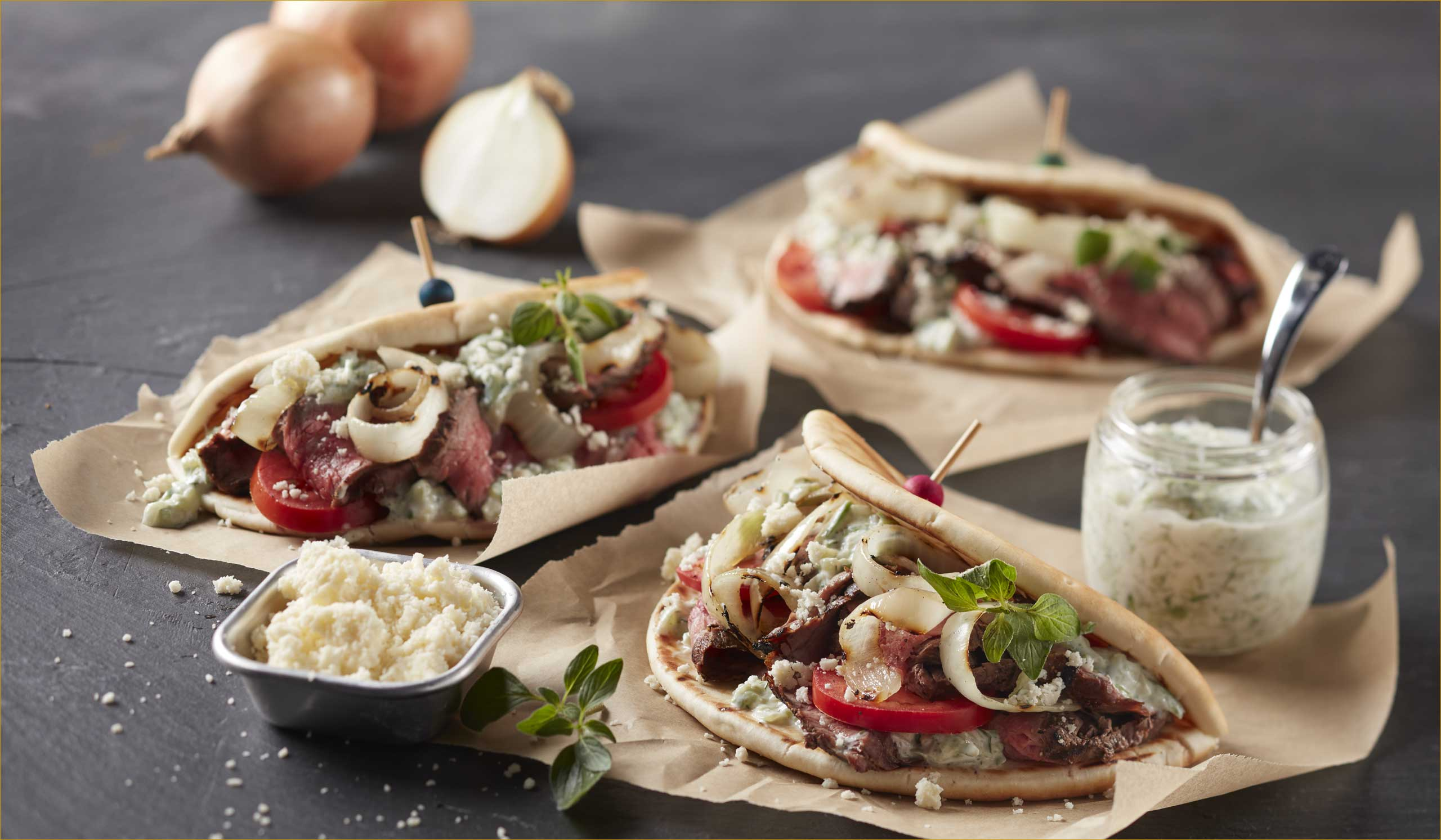 Open-Face Grilled Beef Gyros with Charred Onions & Cucumber Yogurt Sauce